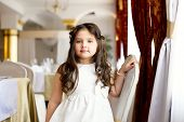 Beautiful little fashionista posing in restaurant