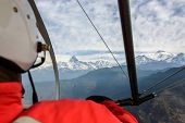 Pilot flying an ultralight in Nepal