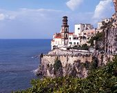 Town on cliffs by sea, Atrani, Italy.