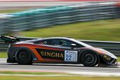 SEPANG, MALAYSIA - MAY 11, 2014: Driver Sanchai Engtrakul in a Lamborghini LP600 car speeds off afte