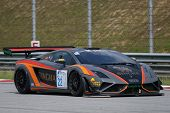 SEPANG, MALAYSIA - MAY 11, 2014: Driver Sanchai Engtrakul in a Lamborghini LP600 car races down the