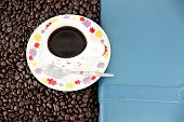 Coffee Beans And White Cup In Concept.