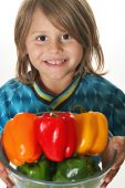 Cute Little Boy Holding Colorful Peppers