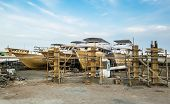 Old Boats Are Being Repaired On The Shore At The Port