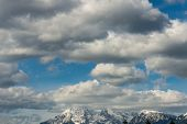 Cloudscape Over Snow Covered Mountains