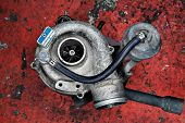 Old worn out turbocharger of a turbo diesel engine