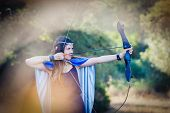elven wood princess shooting bow and arrow
