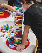 Children Play With Lego Bricks In Milan, Italy