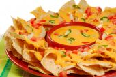 image of nachos  - Plate of fresh nachos with a spicy jalapeno cheese sauce