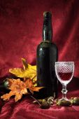 foto of beechnut  - Vintage red wine glass and bottle with fall decoration details - JPG