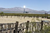 IVANPAH, CALIFORNIA - May 14, 2014:  New industrial scale solar power tower glows above abandoned ca