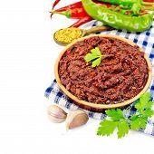 Adjika With Hot Pepper On A Napkin