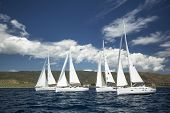 AEGEAN SEA, GREECE - MAY 4, 2014: Unidentified sailboats participate in sailing regatta