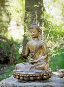 stock photo of siddhartha  - Small statue of Buddha in outdoor - JPG