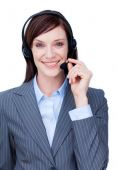 Portrait Of A Smiling Businesswoman With Headset On