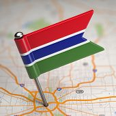 Gambia Small Flag on a Map Background.