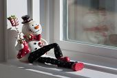 Reclining snowman doll