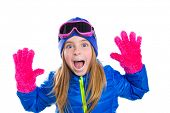 blond kid girl winter snow portrait with open hands pink gloves shouting gesture