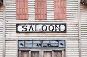 Saloon Iscription On Wooden Building Facade