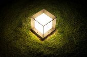 Lighting Cube Lantern On Grass At Night.