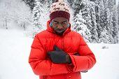 African American Cheerful Black Man In Ski Suit In Snowy Winter Outdoors, Almaty, Kazakhstan, Asia