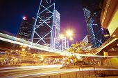 Road Light Trails On Modern City Landmark Buildings In Hongkong