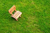 Wooden Stool On Green Grass Field