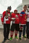 Russian and Belarussian hockey fans in costumes