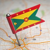 Grenada Small Flag on a Map Background.