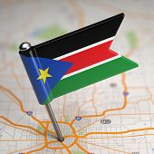 image of sudan  - Small Flag Republic of South Sudan on a Map Background with Selective Focus - JPG