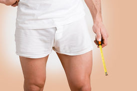 foto of masturbate  - Concept of a man with a big penis with a measuring tape in the hand - JPG