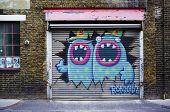 LONDON, UK - APRIL 18, 2014: Graffiti, posters and stickers on Fashion Street, Spitalfields / Whitechapel.