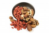 Goji Berries And Nuts Spilling From A Bowl