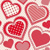 Seamless pattern with dotted hearts.