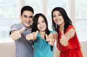 Cheerful Friends Showing Thumbs-up