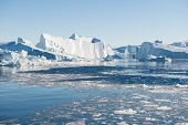 foto of iceberg  - Beautiful Icebergs in Disko Bay Greenland around Ilulissat with blue sky - JPG