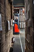 reach truck driver in a warehouse with lots of copy space