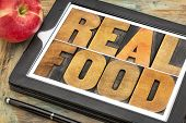 healthy lifestyle concept - real food, text in vintage letterpress wood type on a digital tablet with a fresh apple