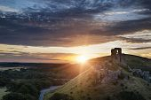 Castle Ruins Landscape At Sunrise With Inspirational Sunburst Behind Castle