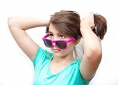 young teenager with sun glasses and attitude. Isolated on white