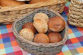 foto of baps  - A Wicker Basket of Freshly Made Round Bread Rolls - JPG