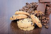 Close up cookies, coffee beans and chocolate