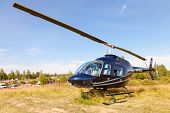 Borovichi, Russia - July 12, 2014: Helicopter Bell Jet Ranger Iii On The  Motocross Competition