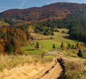Road In The Mountains In Autumn Forest