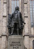 pic of leipzig  - The Neues Bach Denkmal meaning new Bach monument stands since 1908 in front of the St Thomas Kirche church where Johann Sebastian Bach is buried in Leipzig Germany - JPG