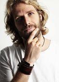 stock photo of long beard  - blond man touching his beard and watching at camera - JPG
