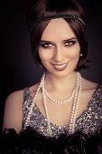 Beautiful retro woman 20s style in silver dress