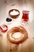 stock photo of bagel  - Turkish bagel simit and traditional tea on a table  - JPG
