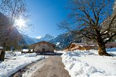 Winter landscape in a mountain valley with huts.Tyrol Austria.