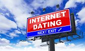 Internet Dating on Red Billboard.